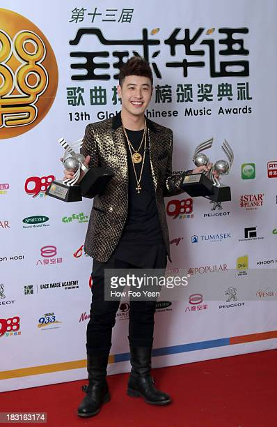 Wilber Pan of Chinese Taipei poses with his Awards at back stage during the 13th Global Chinese Music Awards at Putra Stadium on October 5 2013 in...