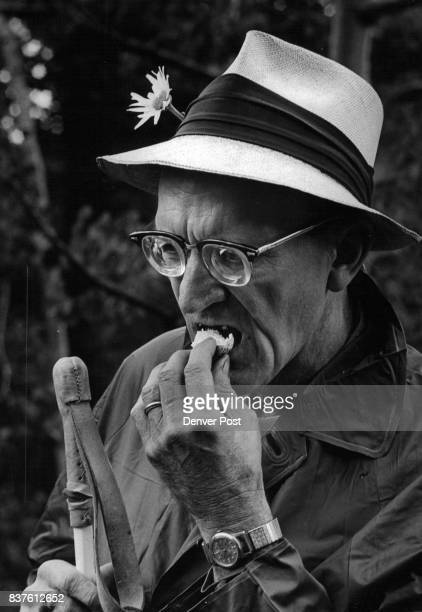 Wilbert J Moehrke partially sighted takes a bite of an edible mushroom identified on the trip Moehrke a member of the Colorado Mountain Club...