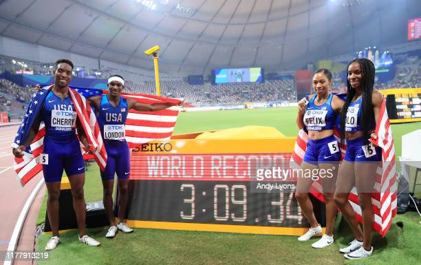 Wilbert London Michael Cherry Courtney Okolo and Allyson Felix of the United States pose after setting a new world record in the 4x400 Metres Mixed...