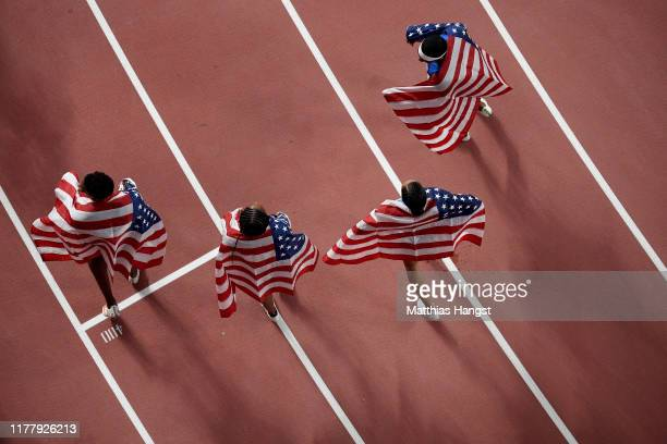Wilbert London, Michael Cherry, Courtney Okolo and Allyson Felix of the United States pose after setting a new world record in the 4x400 Metres Mixed...