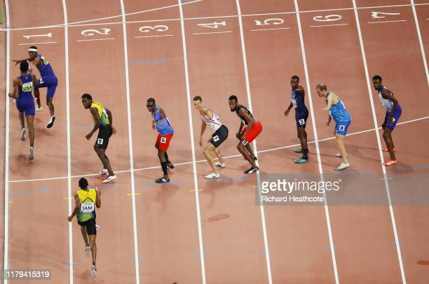 Wilbert London of the United States gets the baton from Michael Cherry in the Men's 4x400 metres relay final during day ten of 17th IAAF World...