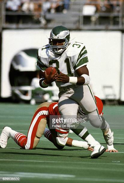 Wilbert Montgomery of the Philadelphia Eagles carries the ball against the San Francisco 49ers during an NFL football game circa 1981 at Veterans...
