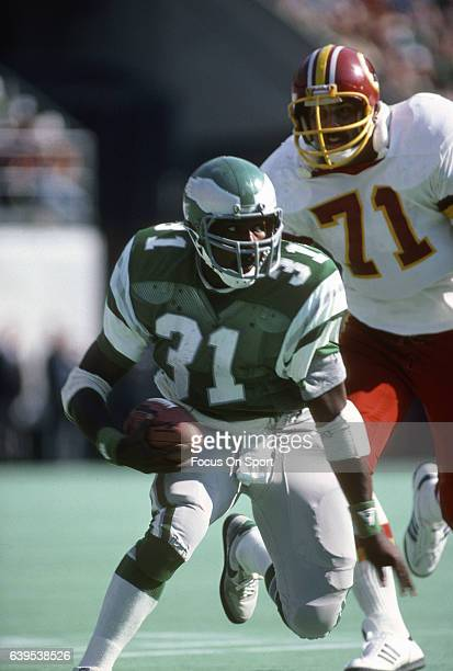 Wilbert Montgomery of the Philadelphia Eagles carries the ball against the Washington Redskins during an NFL football game circa 1981 at Veterans...