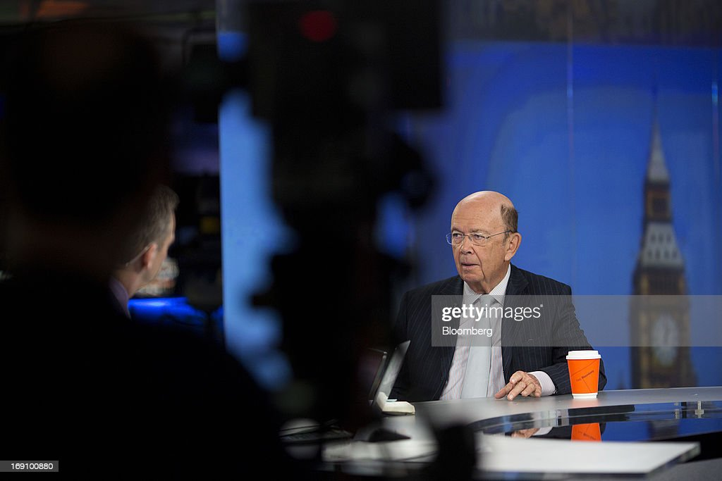 Wilbur Ross, billionaire and chief executive officer of WL Ross & Co. LLC, right, speaks during a Bloomberg Television interview in London, U.K. on Monday, May 20, 2013. Ross said he intends to add to his shipping investments as slowing growth of the merchant fleet spurs an industry recovery as soon as next year. Photographer: Simon Dawson/Bloomberg via Getty Images