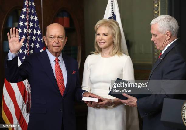 Wilbur Ross is sworn in to be Commerce Secretary by Vice President Mike Pence as his wife Hilary Geary Ross holds a bible on February 28 2017 in...