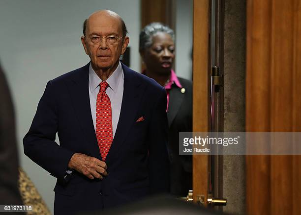 Wilbur Ross picked by Presidentelect Donald Trump to serve as his commerce secretary arrives to testify at his confirmation hearing in front of the...