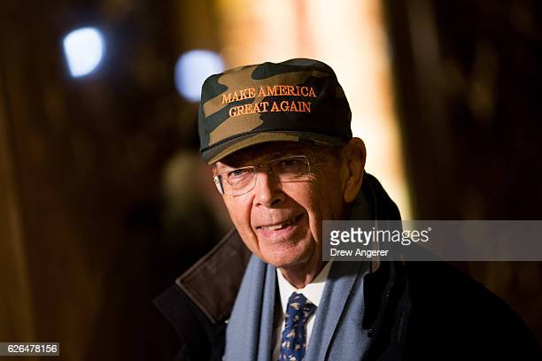 Wilbur Ross Presidentelect Donald Trump's choice for Commerce Secretary wears a 'Make America Great Again Hat' as he speaks briefly to reporters at...