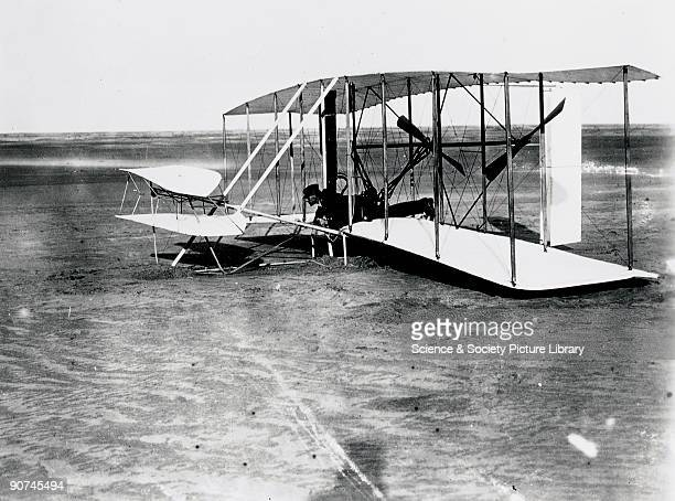 Wilbur Wright at the controls of the 'Flyer' at Kitty Hawk North Carolina United States Orville Wright and his brother Wilbur were selftaught...
