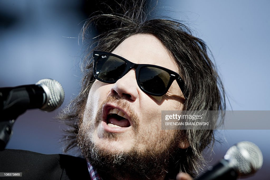 Wilco lead singer Jeff Tweedy sings during the 'Rally To Restore Sanity and/or Fear' on the national Mall October 30, 2010 in Washington, DC. Tens of thousands of people streamed into the US capital Saturday for the rally hosted by liberal comics Jon Stewart and Stephen Colbert, billed as an antidote to the ugly political mood dividing the US three days before mid-term elections. AFP PHOTO/Brendan SMIALOWSKI