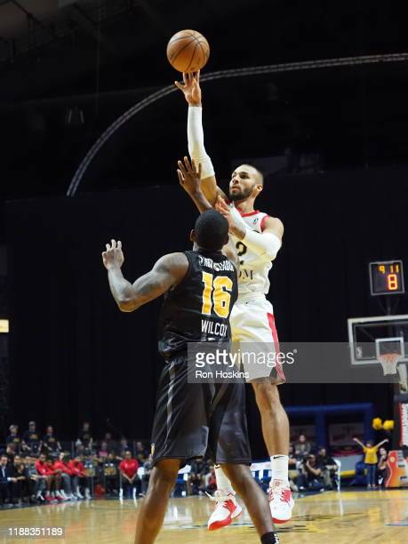 C J Wilcox of the Fort Wayne Mad Ants shoots the ball against Taren Sulllivan of the Erie Bayhawks on December 13 2019 at Memorial Coliseum in Fort...