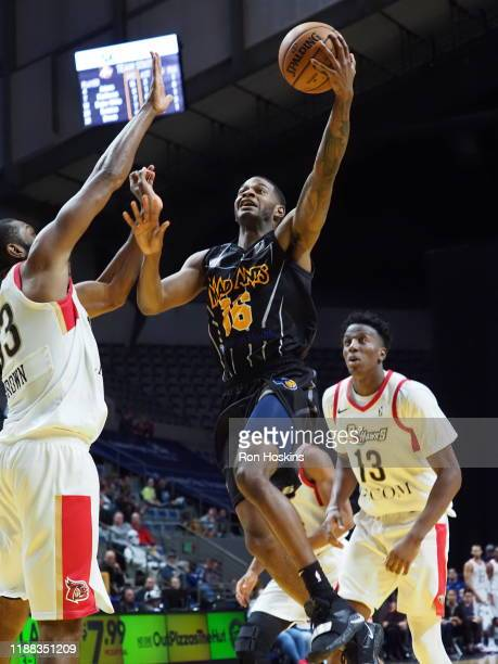 J Wilcox of the Fort Wayne Mad Ants shoots the ball against Vitto Brown and Kavell BigbyWilliams of the Erie Bayhawks on December 13 2019 at Memorial...