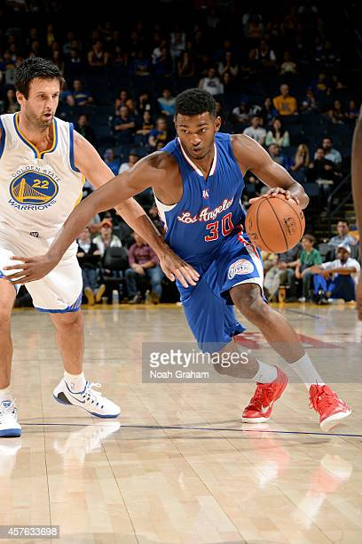 J Wilcox of the Los Angeles Clippers drives towards the hoop against Jason Kapono of the Golden State Warriors on October 21 2014 at Oracle Arena in...