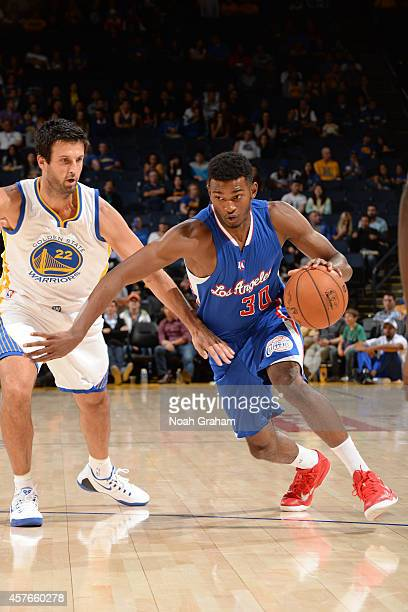 J Wilcox of the Los Angeles Clippers handles the ball against Jason Kapono of the Golden State Warriors on October 21 2014 at Oracle Arena in Oakland...