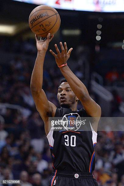 J Wilcox of the Los Angeles Clippers shoots the ball against the Phoenix Suns in the first half at Talking Stick Resort Arena on April 13 2016 in...