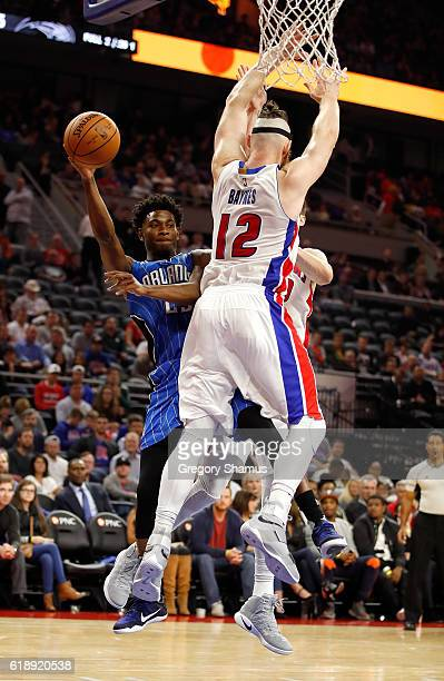 J Wilcox of the Orlando Magic passes around Aron Baynes of the Detroit Pistons during the second half at the Palace of Auburn Hills on October 28...