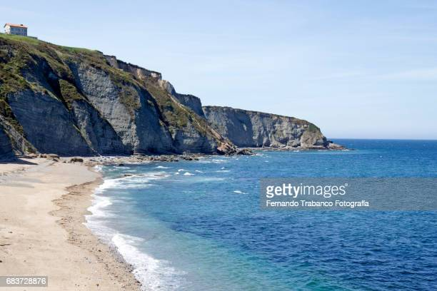 Wild and nudist beach in Asturias, nature of sea and mountain calm sea