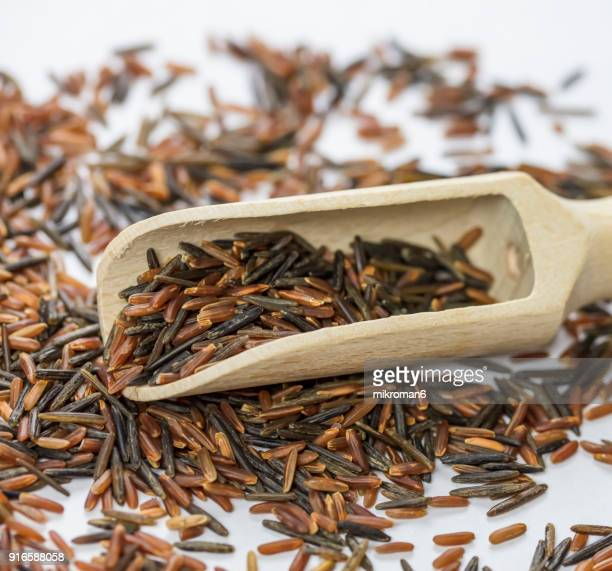 wild, black and red rice directly above view, macro shot. traditional food. - black rice stock pictures, royalty-free photos & images