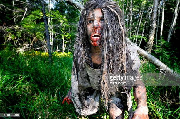 wild boy on the move - caveman stock photos and pictures