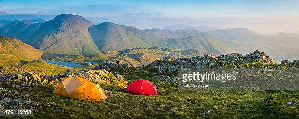 wild camp tents on mountain top lake district sunrise panorama - cumbria stock pictures, royalty-free photos & images