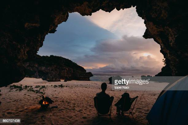 Wild camping in cave on beach with sunset, Japan