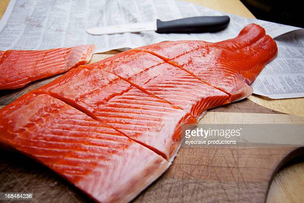 wild caught salmon raw fillet on cutting board - fillet stock pictures, royalty-free photos & images