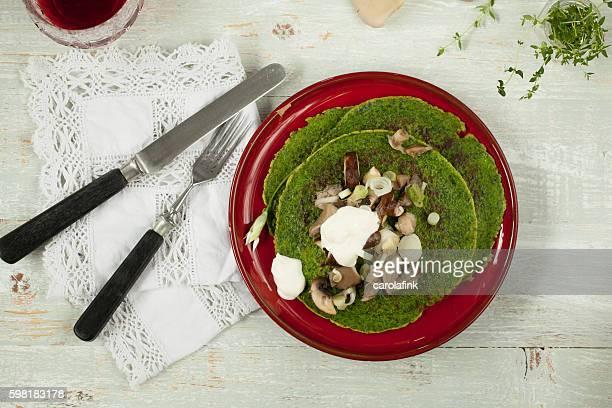 wild garlic pancakes - carolafink stock pictures, royalty-free photos & images