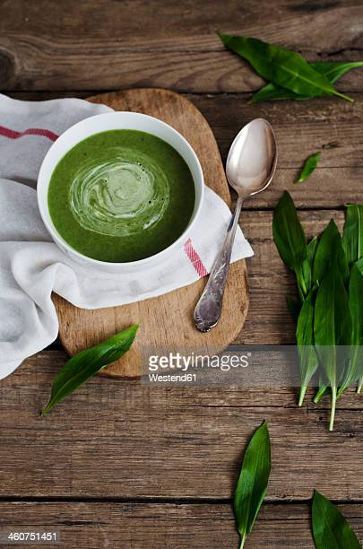 Wild garlic soup on table, close up