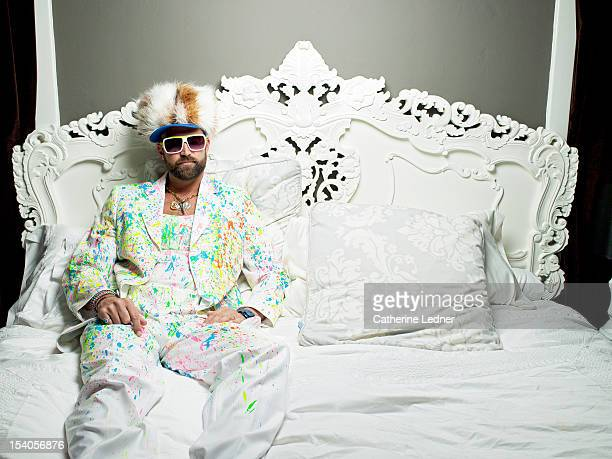 wild henry - multi colored suit stock photos and pictures