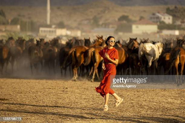Wild horses living at the foothills of Mount Erciyes are seen at Hurmetci Reed in Kayseri, Turkey on July 3, 2021. Hurmetci Reed hosting herds of...