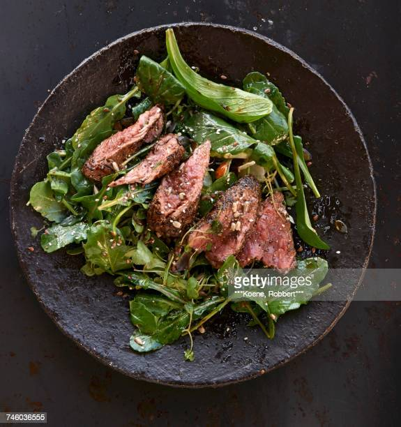 wild lettuce with peppered steak - fish love ストックフォトと画像