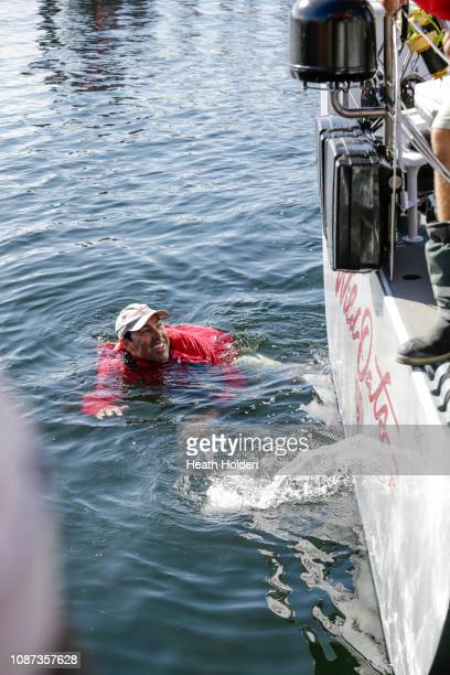 Wild Oats skipper Mark Richards gets thrown in the water by team mates after they took their 9th Line Honours in the 2018 Sydney to Hobart yacht race...
