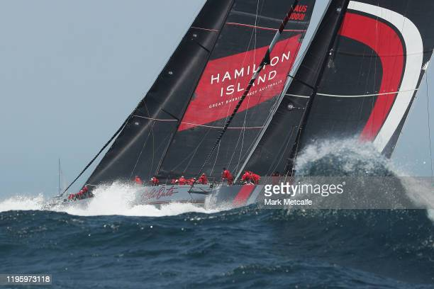 Wild Oats XI and Scallywag race through the heads as they leave Sydney Harbour during the 2019 Sydney to Hobart on December 26 2019 in Sydney...