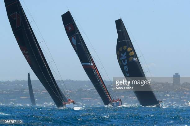 Wild Oats XI Comanche and Scallywag during the start of the Sydney to Hobart Yacht race on December 26 2018 in Sydney Australia