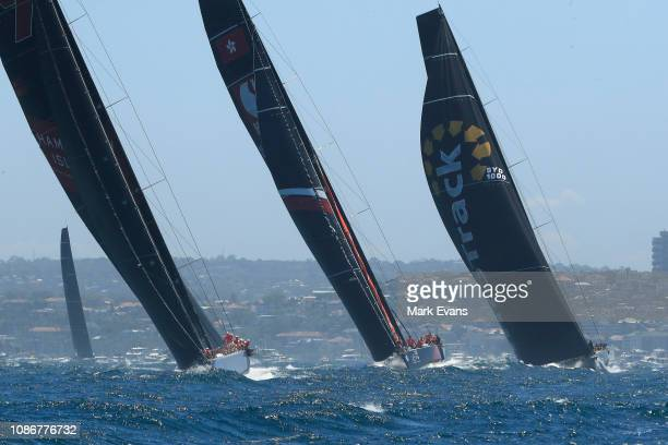 Wild Oats XI Scallywag and Infotrack during the start of the Sydney to Hobart Yacht race on December 26 2018 in Sydney Australia