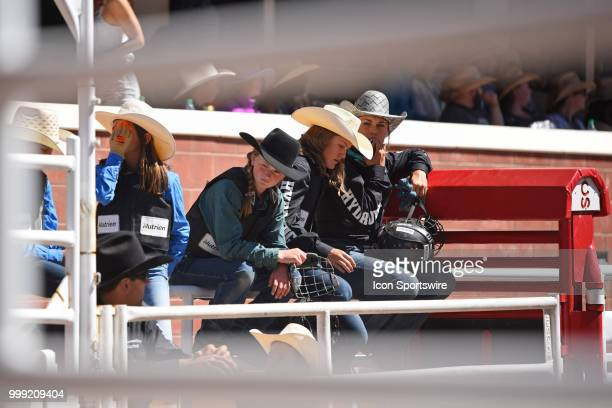 Wild pony competitors watch the action at the Calgary Stampede on July 14 2018 at Stampede Park in Calgary AB