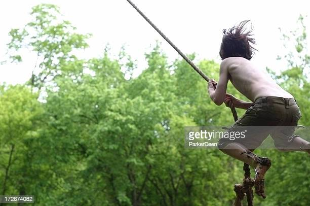wild rope swing jump - leap of faith stock photos and pictures