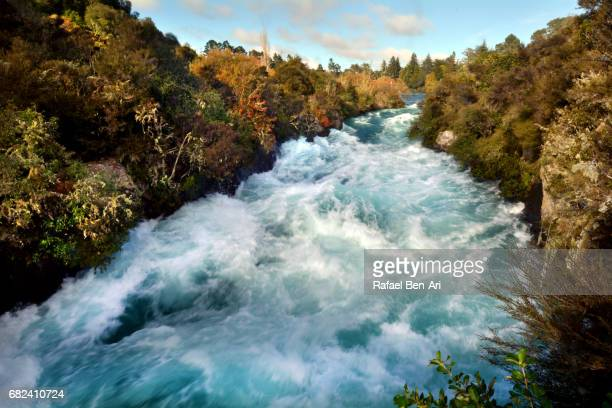 wild rushing stream of huka falls new zealand - rafael ben ari stockfoto's en -beelden