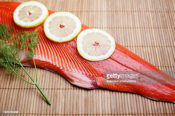 Wild Salmon raw fillet on bamboo