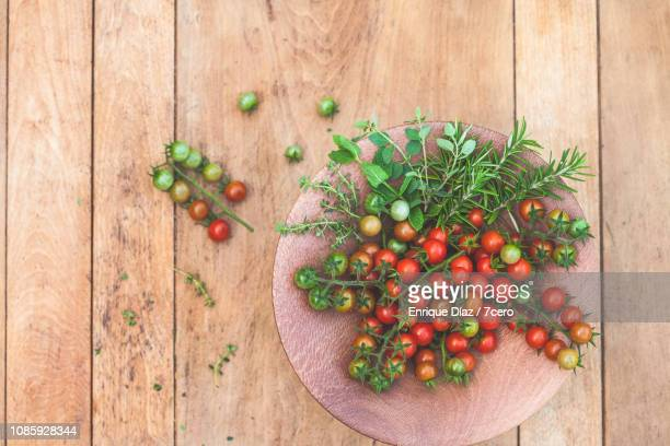Wild Sown Cherry Tomatoes and Herbs on Wood