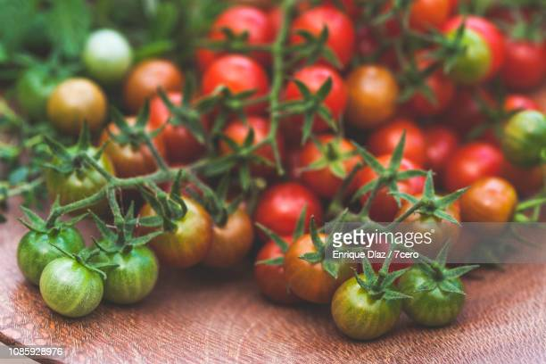 Wild Sown Cherry Tomatoes on Wooden Cake Stand, Close-Up
