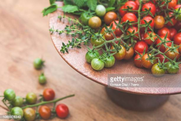 Wild Sown Cherry Tomatoes on Wooden Cake Stand