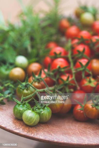 Wild Sown Cherry Tomatoes on Wooden Plate