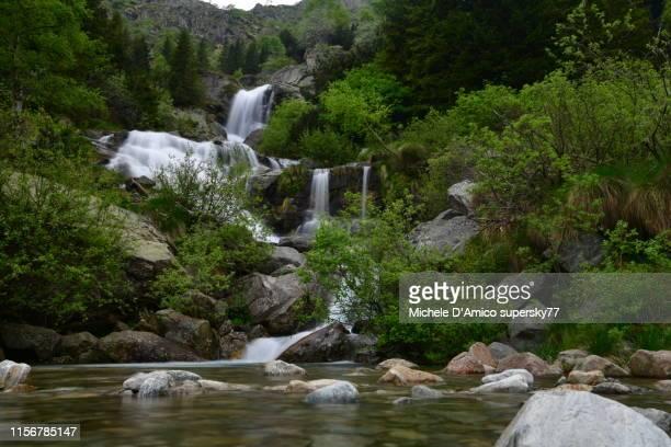 wild stream with waterfall, with long exposure - ビエラ ストックフォトと画像
