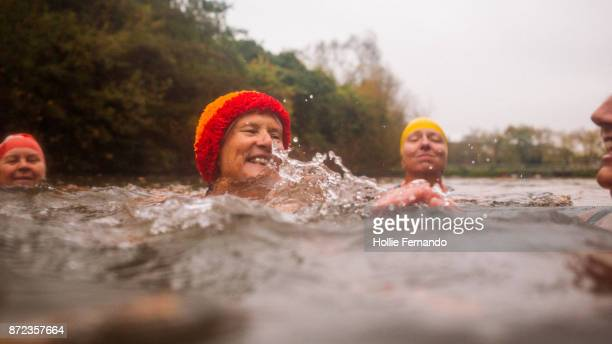 wild swimming women's group autumnal swim - 50 59 years stock pictures, royalty-free photos & images