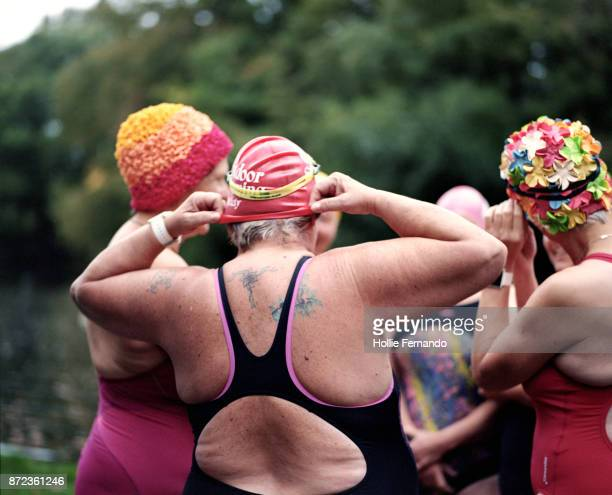 wild swimming women's group autumnal swim - disruptaging stock photos and pictures