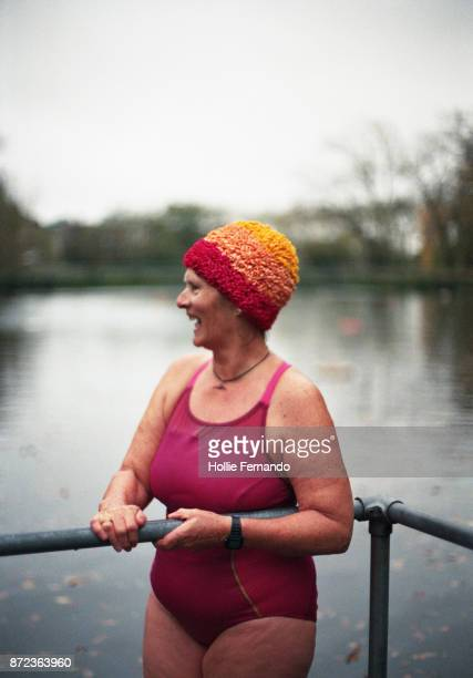 wild swimming women's group autumnal swim - pond stock pictures, royalty-free photos & images