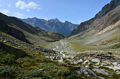 WIld U-shaped valley in the Alps