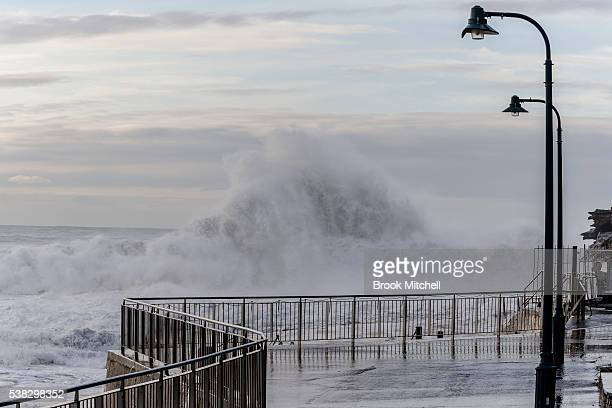Wild waves continue to hit the coast at Bronte Beach on June 6 2016 in Sydney Australia Torrential rain over the weekend saw streets and homes...