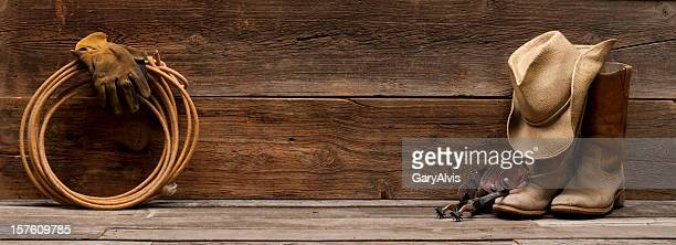 wild west barnwood background w/boots,hat,spurs,rope - cowboy hat stock pictures, royalty-free photos & images