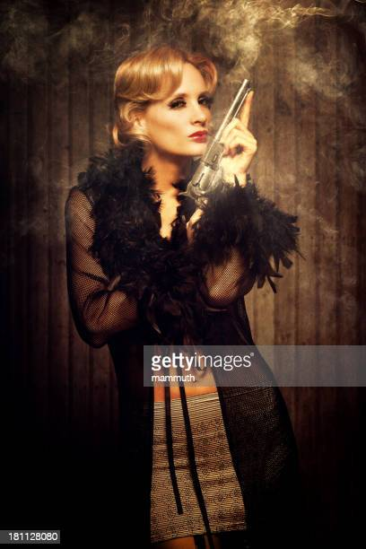 wild west diva holding a smoking gun